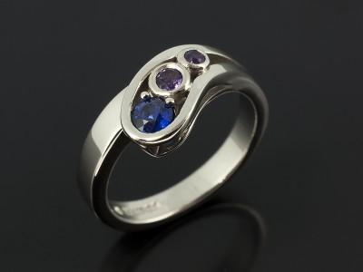Palladium Rub Over Set Twist Design Comprising Round Brilliant Sapphire and Amethysts.