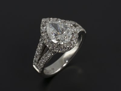 Pear Cut 1.23ct D Colour SI2 Clarity EXEX in a Platinum Diamond Claw Set Halo and Double Shoulder Design.