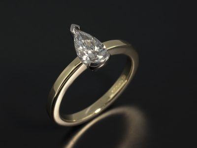 Pear Cut 0.71ct D Colour SI2 Clarity EXEX in an 18kt White and Yellow Gold Solitaire Design.