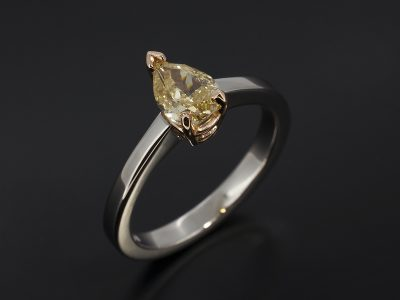 Pear Cut Diamond 0.78ct Fancy Yellow in a 18kt Rose Gold and Palladium Claw Set Design.