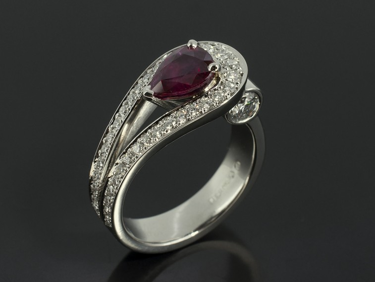 Pear Cut Ruby 1.18ct in a Platinum Pavé Diamond Set Double Band with 2 x 0.20ct F VS Round Brilliant Diamonds.