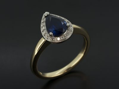 Pear Shape Sapphire, 1.04ct Claw Set in Platinum with a Round Brilliant Cut Diamond Pavé Set Halo on a 18kt Yellow Gold Shank