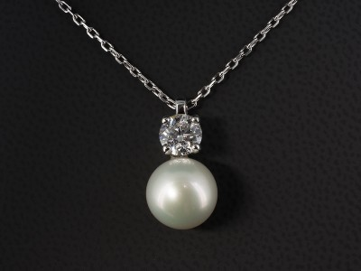 Pendant with Round Brilliant Cut Diamond 0.91ct E Colour SI1 Clarity with a Fresh Water Ivory Pearl in 18kt White Gold.