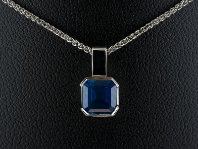 Asscher Cut Sapphire 1.22ct in a 9kt White Gold Half Rub Over Set Pendant.