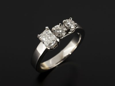 Radiant Cut Diamond 0.51ct E Colour IF Clarity Set in Platinum with Two Round Brilliant Cut Diamonds 0.30ct (2) in an Offsett Trilogy Design