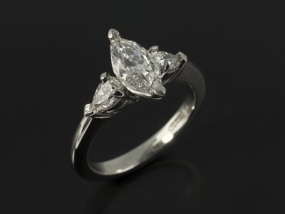 Marquise 0.62ct D Colour VS2 Clarity with Side Pear Cut Diamonds 0.35ct Total in a Platinum Trilogy Design.
