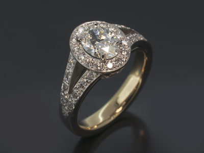 Oval Cut 0.71ct G Colour VVS2 Clarity in a Platinum and 9kt Yellow Gold Pavé Set Halo and Split Shoulders Design.