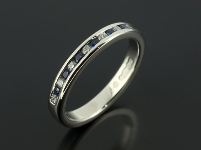 Platinum Round Diamond and Sapphire Channel Set Wedding Ring.