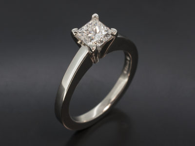 Princess Cut 0.80ct D Colour SI2 Clarity Ex Polish Ex Symmetry in a Classic Platinum 4 Claw Solitaire Design.