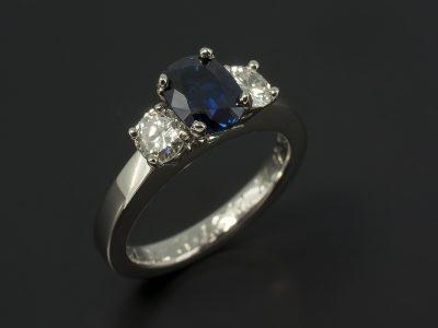 Oval Cut Sapphire 0.96ct and 2 x Round Brilliant Cut Diamonds 0.24ct Total F VS in a Platinum 4 Claw Set Trilogy Design.
