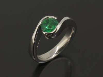 Round Brilliant Cut Emerald, 0.94ct Part Tension Set in Platinum in a Twist Design