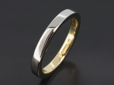 Platinum and 18kt Yellow Gold Two Tone Inner Sleeve Design Wedding Ring.