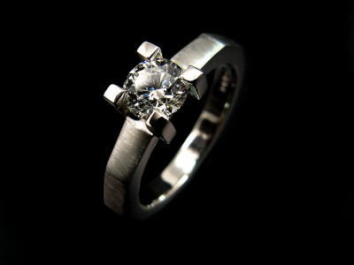 Platinum 4 claw, Edged Band Engagement Ring with a 0.60ct F colour SI1 clarity Excellent Cut Grade Round Brilliant Diamond