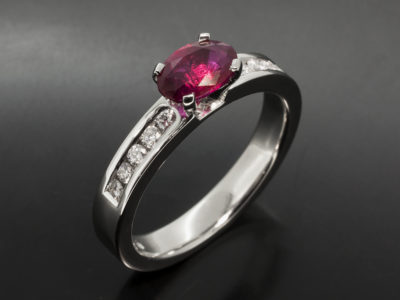 Platinum Four Claw & Channel Set Design Oval Cut Ruby, 1.02ct Round Brilliant Cut Diamonds, 0.19ct (10)