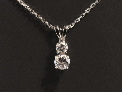 Platinum Four Claw Two Diamond Drop Pendant Design with Double Bale and Trace Chain. Round Brilliant Cut Diamonds 0.43ct and 0.17ct F Colour SI Clarity Minimum.
