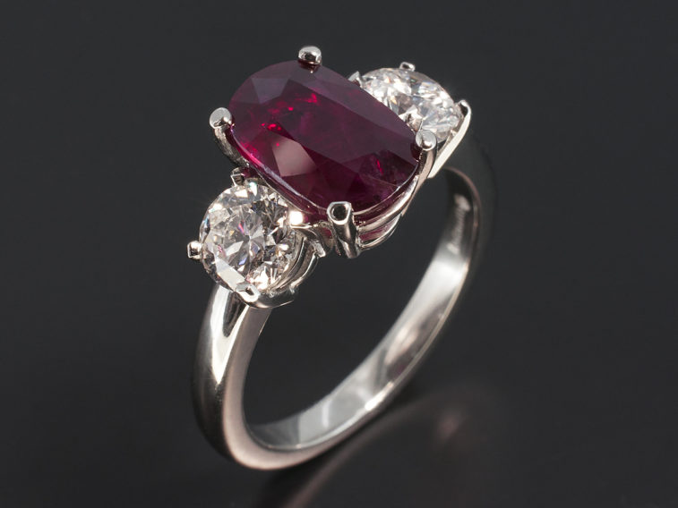 Platinum 4 claw set ruby and diamond trilogy design ring