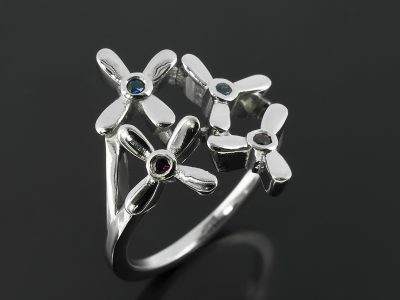 Platinum Petal Inspired Ring with Round Sapphires and Rubies.