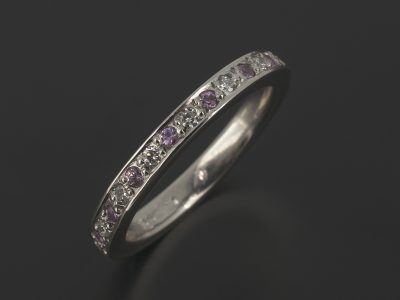 Platinum Wedding / Eternity Ring with Round Brilliant Pavé Set Diamonds and Pink Sapphies.