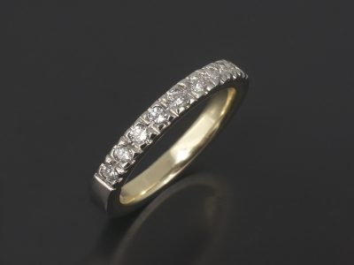 Platinum Claw Set Wedding / Eternity Ring with 0.27ct Round Brilliant Cut Diamonds and an 18kt Yellow Gold Inner Sleeve.