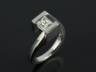 Princess Cut 0.55ct F Colour VS1 Clarity in an 18kt White Gold Twist Tension Set Design.
