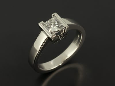 Princess Cut 0.70ct D Colour VS1 Clarity in a Platinum Half Rub Over Set Solitaire Design.