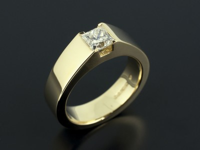 Princess Cut 0.80ct E VVS2 in a 18kt Yellow Gold Tension Setting.