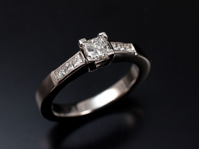 Princess Cut 0.36ct G Colour VS2 Clarity in a 9ct White Gold Setting with 6 x Princess Cuts Channel Set into Shoulders.