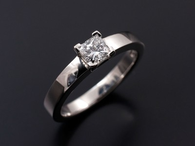 Princess Cut 0.45ct E SI1 in a 4 Claw Platinum Setting with Square Edged Band.