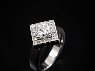 Princess Cut 1.01ct E VS2 with 16 x 0.03ct (0.56ct) F VS Princess Cut Diamonds Channel Set around Main Stone. Hand Made in Platinum