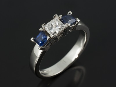 Princess Cut 0.41ct D Colour VVS2 Clarity with Princess Cut Sapphires 0.48ct in a Platinum Trilogy Setting.