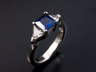 Palladium Trilogy Setting with Princess Cut Sapphire 0.84ct. Trilliant Cut Diamonds 0.38ct G Colour VS Clarity Min