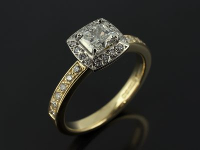 Radiant Cut 0.71ct H Colour VS1 Clarity in an18kt Two Tone White and Yellow Gold Pavé Diamond Set Halo Design.
