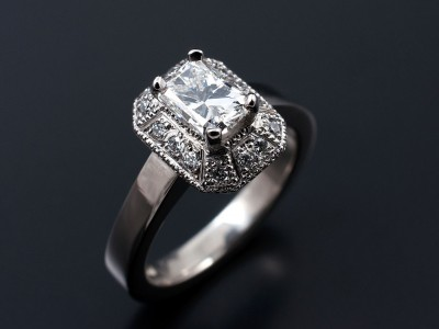 Radiant Cut 0.70ct G VS2 in a Hand Made Palladium Setting with Antique Style Pave Set Halo.