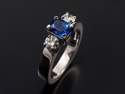 Radiant Cut 0.88ct Sapphire with 2 x 0.20ct F VS Round Brilliants in 18kt White Gold