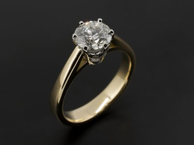 Round Brilliant 1.00ct F Colour SI2 Clarity EXEXVG in an 18kt Yellow and White Gold 6 Claw Solitaire Design.