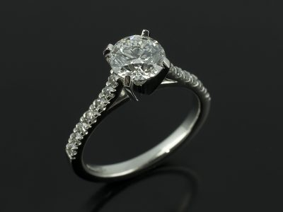 Round Brilliant 1.01ct D Colour SI1 Clarity in a Platinum 4 Claw Setting with Claw Set Diamond Raised Shoulders.
