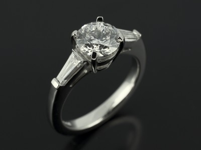 Round Brilliant 1.01ct D Colour SI1 Clarity EXEXEX with 0.40ct Tapered Baguettes in a Platinum Setting.