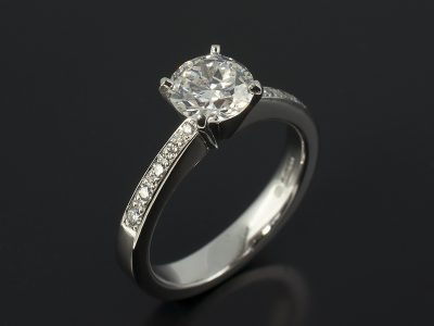 Round Brilliant 1.18ct G Colour SI2 Clarity in a 4 Claw Platinum Diamond Pavé Set Solitaire Design.