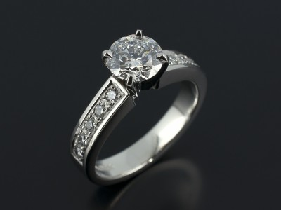Round Brilliant 1.20ct D Colour SI2 Clarity Triple Excellent Grade in a Platinum 4 Claw Setting with Pavé Set Diamond Shoulders.