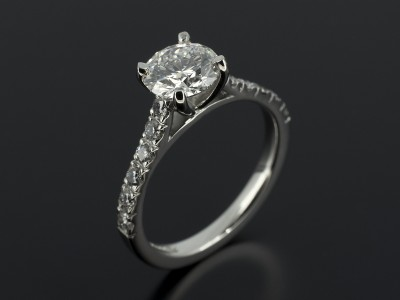 Round Brilliant 1.20ct E Colour SI1 Clarity Triple Excellent Grade with Claw Set Diamond Shoulders in Palladium