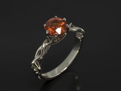 Round Brilliant Cut Orange Sapphire, 1.20ct with a Six Claw Setting In a Palladium Lattice Design