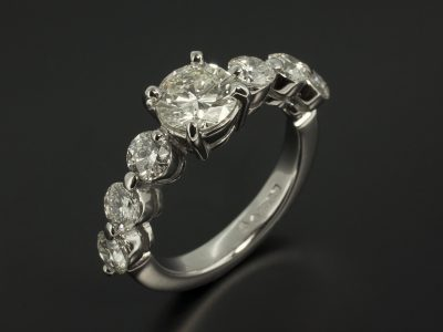 Round Brilliant 1.35ct with 1.87ct Total Side Diamonds in a Platinum Claw Set Design.