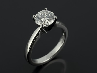 Round Brilliant 1.51ct E Colour SI2 Clarity EXEXEX in a Platinum 4 Claw Solitaire Design.