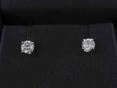 Round Brilliant Cut 0.30ct E Colour SI2 Clarity Platinum Twist Set Earrings.