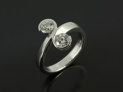 Platinum Binary Rub Over Swirl Design Comprising 2 x Round Brilliant Diamonds 0.41ct D Colour SI1 Clarity.
