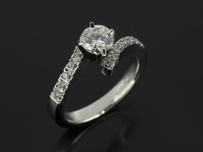 Round Brilliant 0.50ct F Colour SI1 Clarity in a Platinum 4 Claw Twist Design with Diamond Claw Set Shoulders.