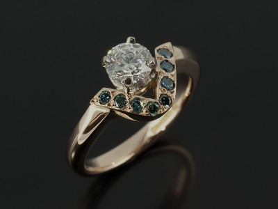 Round Brilliant 0.51ct D Colour SI1 Clarity EXEXEX in a 18kt Red Gold Design with Pavé Set Round Blue Diamonds.