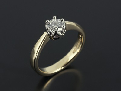 Round Brilliant 0.52ct E Colour SI1 Clarity in a 6 Claw Palladium Setting with 18kt Yellow Gold Band.