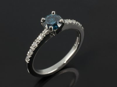 Round Brilliant Blue Diamond 0.56ct in a Palladium 4 Claw Setting with Diamond Claw Set Shoulders.