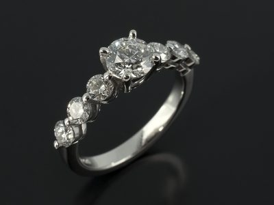 Round Brilliant 0.62ct E Colour SI1 Clarity EXEXEX with 6 x 0.10ct Shoulders Diamonds Claw Set in Platinum.